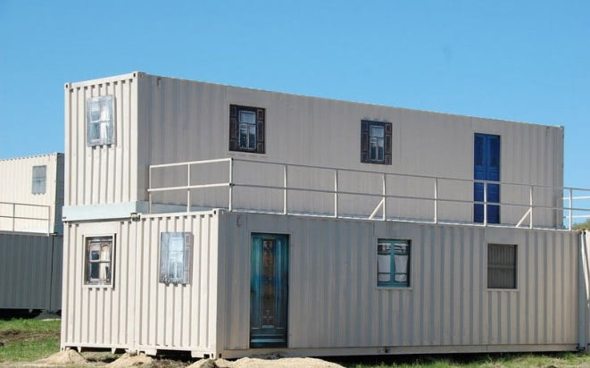 Shipping containers stacked into a building