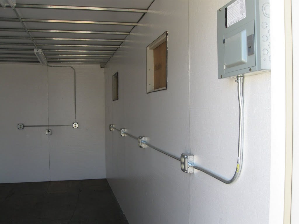 Interior of insulated conex container data center.