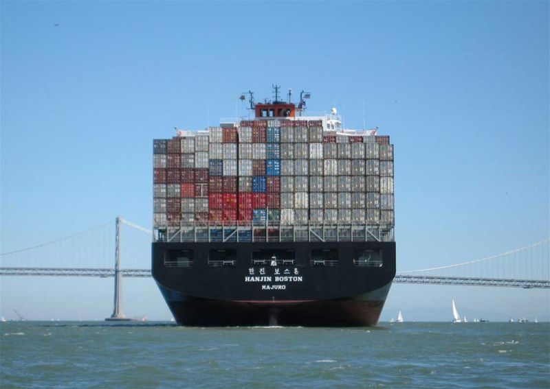 A container ship carries a full haul of shipping containers.