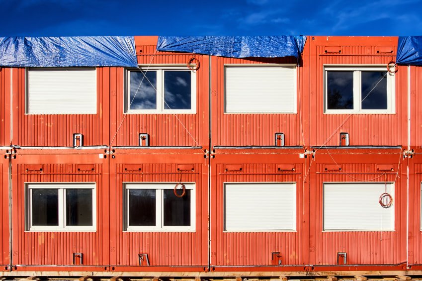 Shipping containers stacked into multi-level structure