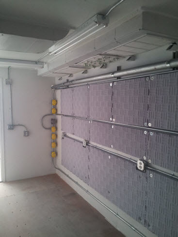 Interior of a shipping container modular control room.