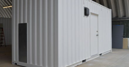 Click to learn more about how shipping container shelters helped a power plant.