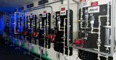 Click to learn more about modular water treatment solutions through shipping containers.