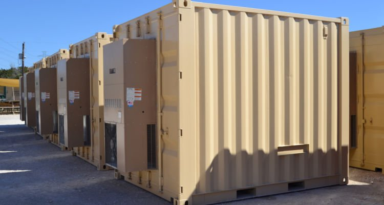 RTU shipping container enclosures ready for use along pipelines.