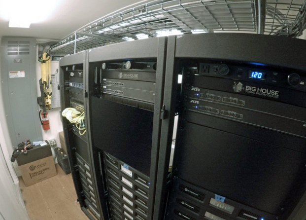 High-tech amplifiers and digital signal processors housed conex audio equipment shelter.