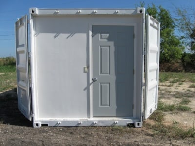 Containerized data center with an insulated wall behind the cargo doors.