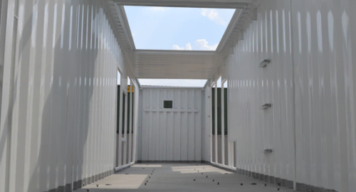 Interior of a 40-foot generator enclosure with custom cut outs for additional industrial equipment.