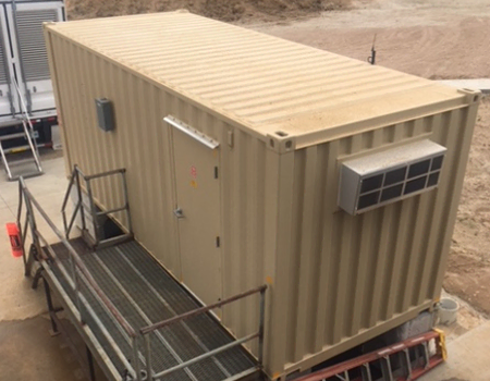 Prefab ISO container shelter built with NEMA enclosure requirements in mind.