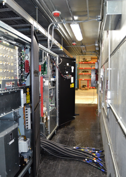 Interior of UPS system in modular equipment shelter with cabling.