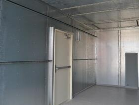 Stainless steel lines the interior of modular shelter for water treatment