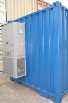 Industrial grade HVAC unit installed in shipping container modified to be a water treatment plant.