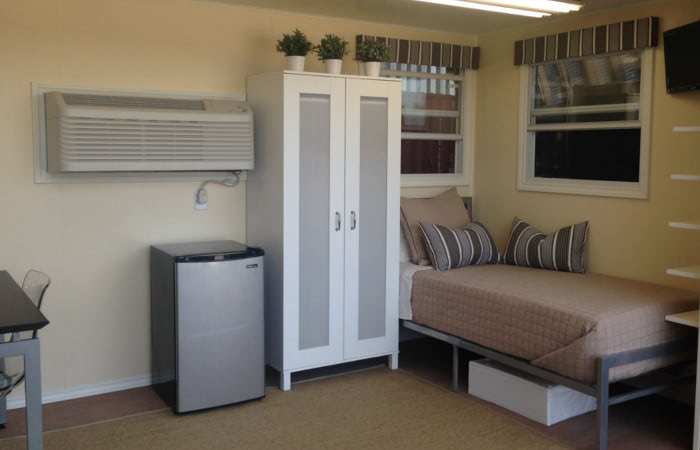 Interior of a furnished workforce housing container.