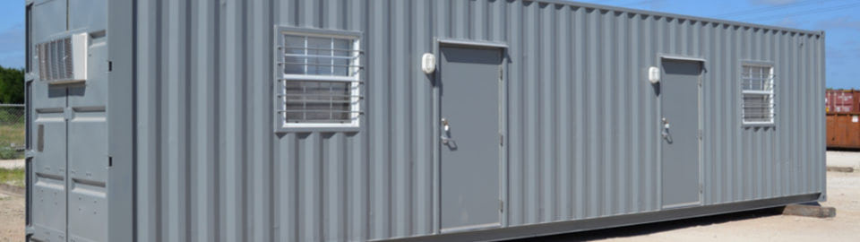 Shipping container modified into a dual living space for oilfield housing.