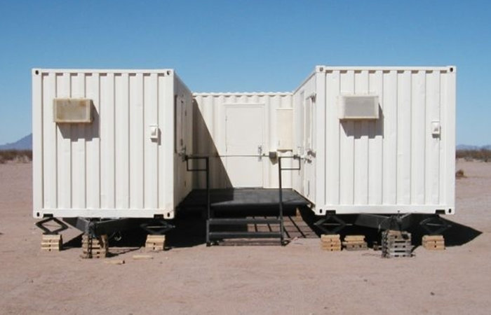 Modified shipping containers are used by border patrol as secure workforce housing.