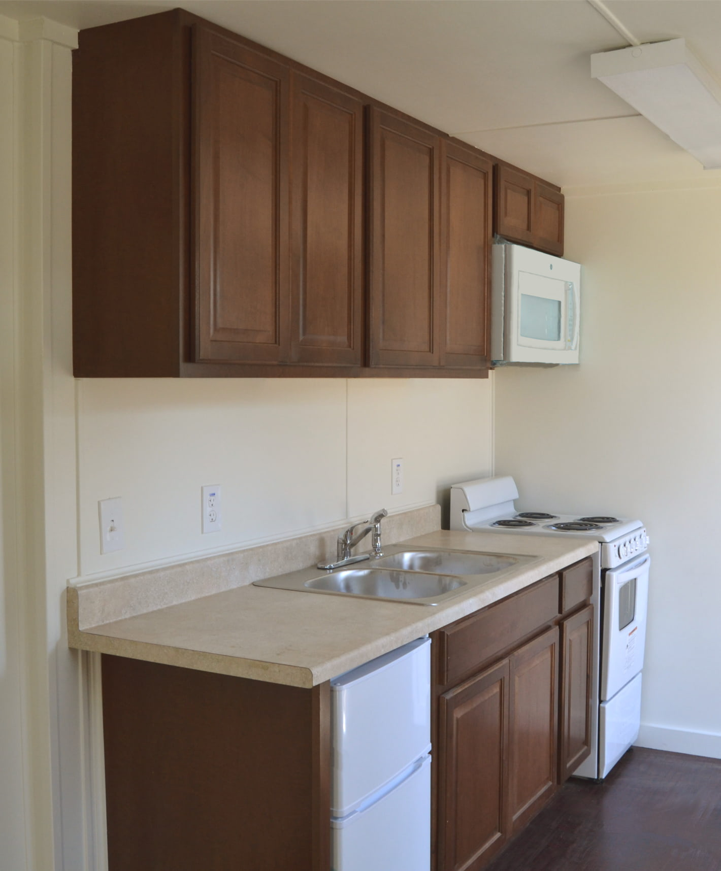 Interior of kitchenette in oil & gas housing unit.
