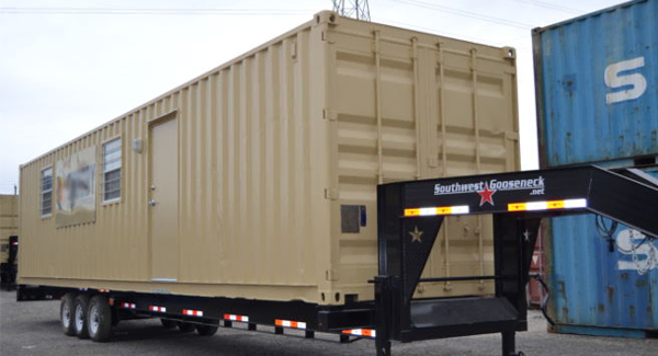 Portable shipping container living unit ready to be shipped to a man camp.