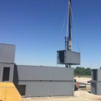 Crane assembles Fortress Obetz with modular construction.