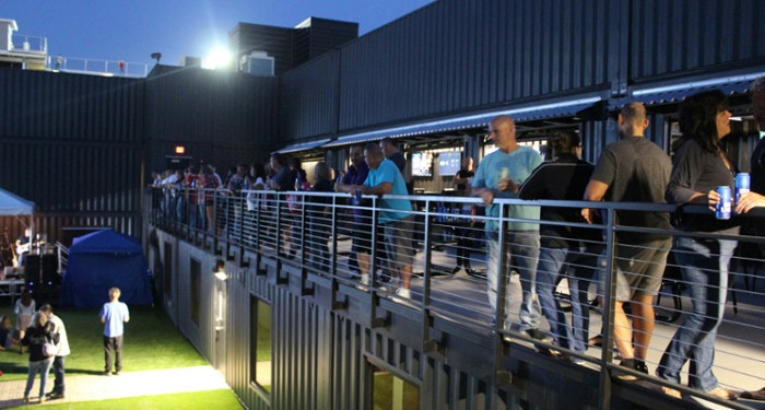 People enjoy a beer inside Fortress Obetz, a shipping container-based stadium