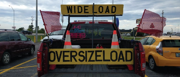 Lead car that may be needed if you are transporting oversize loads for modular construction.