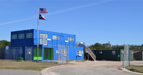 Two story shipping container building that's used as the Falcon Structures headquarters.