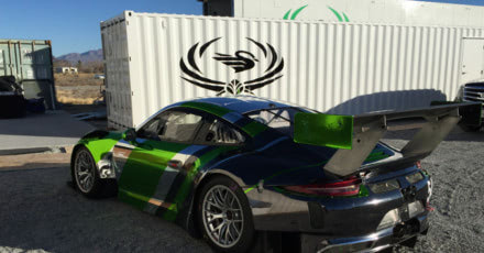 Click to learn more about a conex container modified into a mobile car garage for a ProAm racing team.