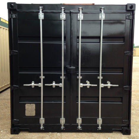 Cargo doors of a shipping container painted black
