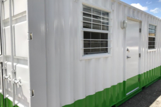 Modified shipping containers give commercial business extra storage for inventory.