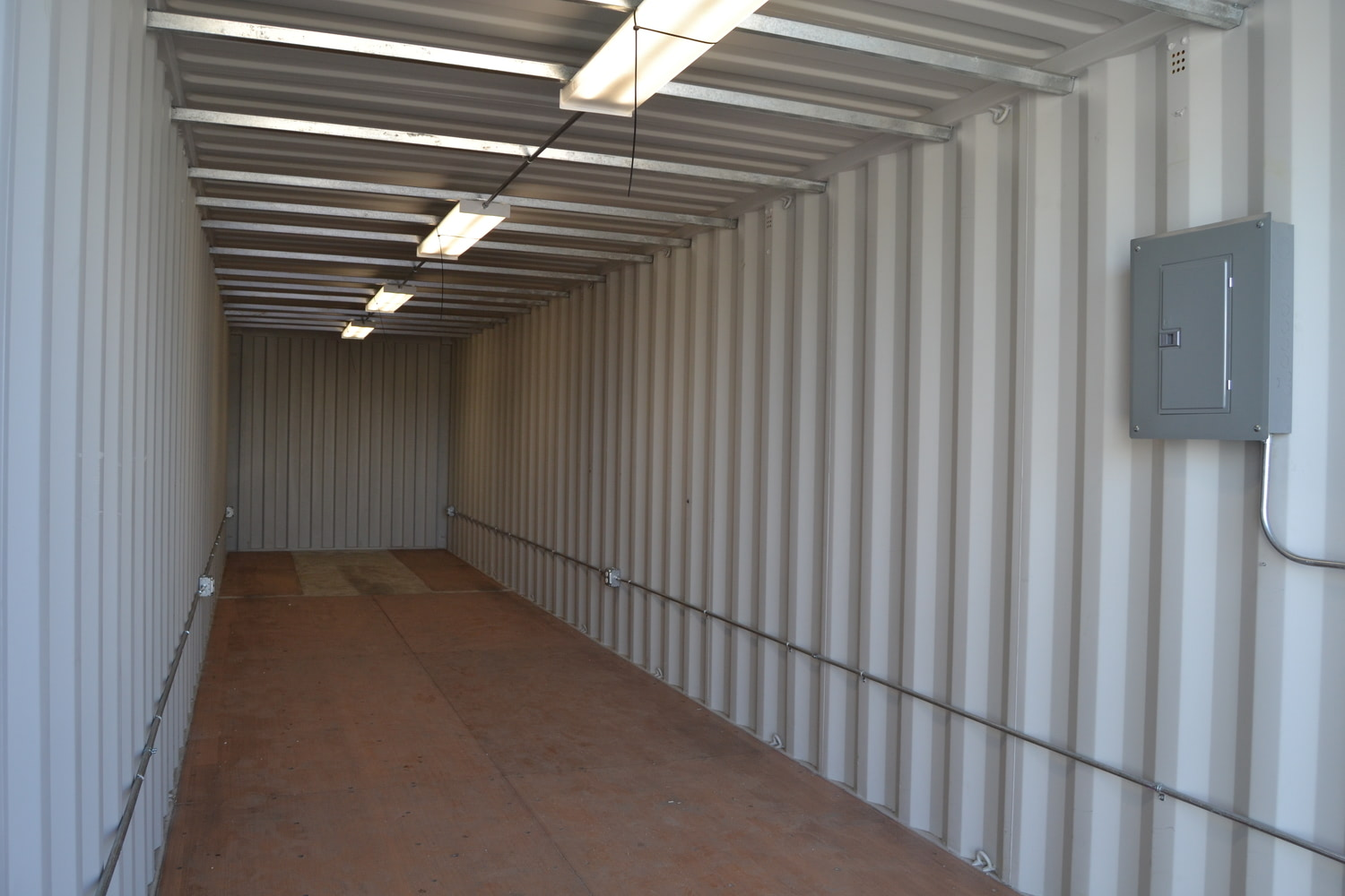 Interior of shipping container modified into portable storage shed.