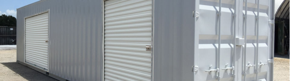 Shipping container modified into a mobile storage space with overhead doors.