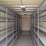 Shipping container storage solutions with shelving