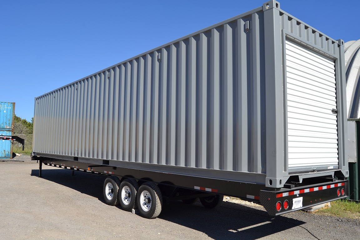 Storage container on a chassis with an overhead door