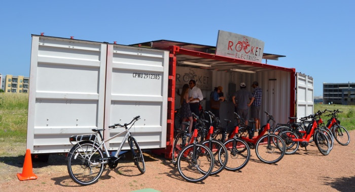Satellite store front with fully open side doors and solar panels.