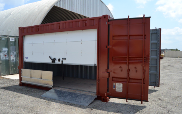 A shipping container modified for storage at a marina with a roll up door and a folding ramp.