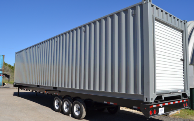 A shipping container storage unit on a chassis is easy to relocate around warehouses.
