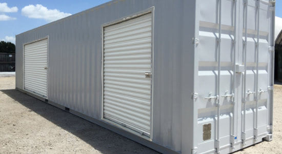 Conex storage containers with two overhead doors for easy access.