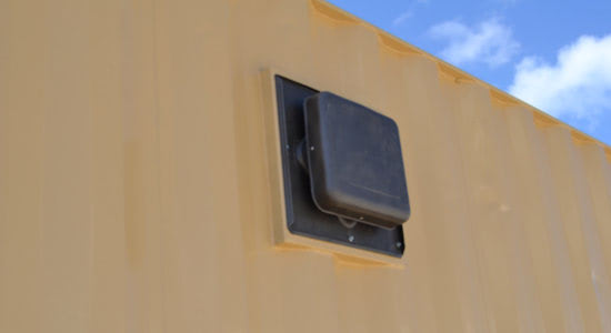 Vent in the side of a shipping container.