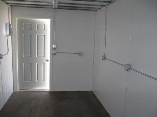 Storage container with personnel door