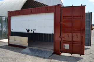 Modified shipping containers provide easy access for warehouse and marina storage.