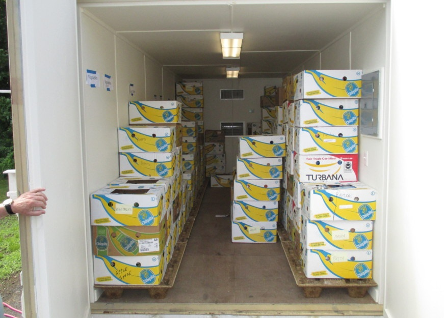 A climate controlled shipping container protects food distributed by a food bank.