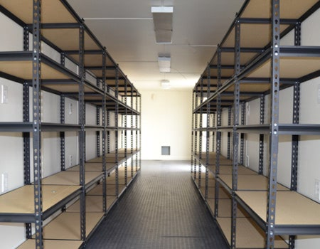Interior of an onsite storage container with shelving.