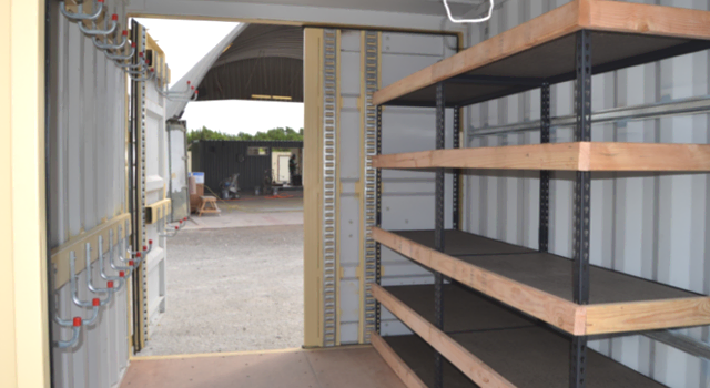 Organized storage within a conex container is ideal for workshops