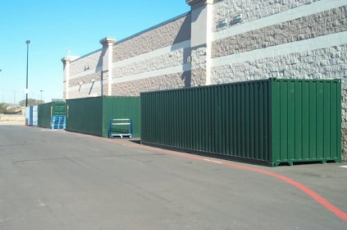 Storage containers holding overflow warehouse goods.