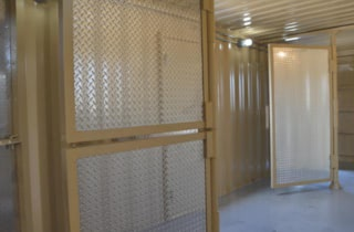 Click to learn more about a shipping container based training facility with custom pivoting walls
