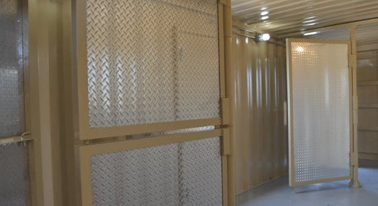 Pivoting doors inside a first responder training facility.