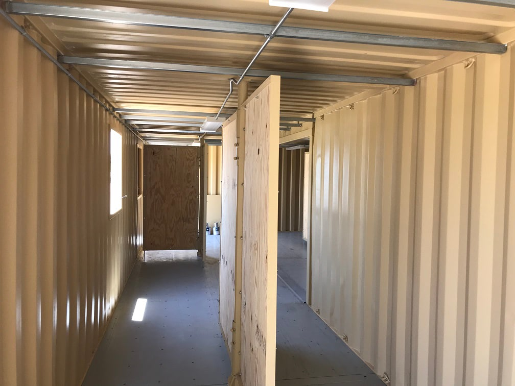 Custom solution for training facility: pivoting interior walls