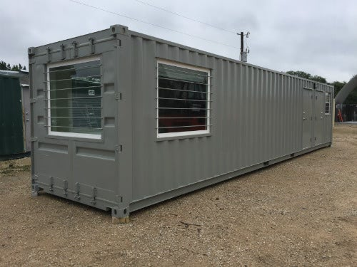 Modified conex office containers are durable enough for oilfield mancamps.