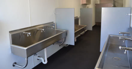 Click to learn more about the shipping container bathroom Falcon made for an oil company.