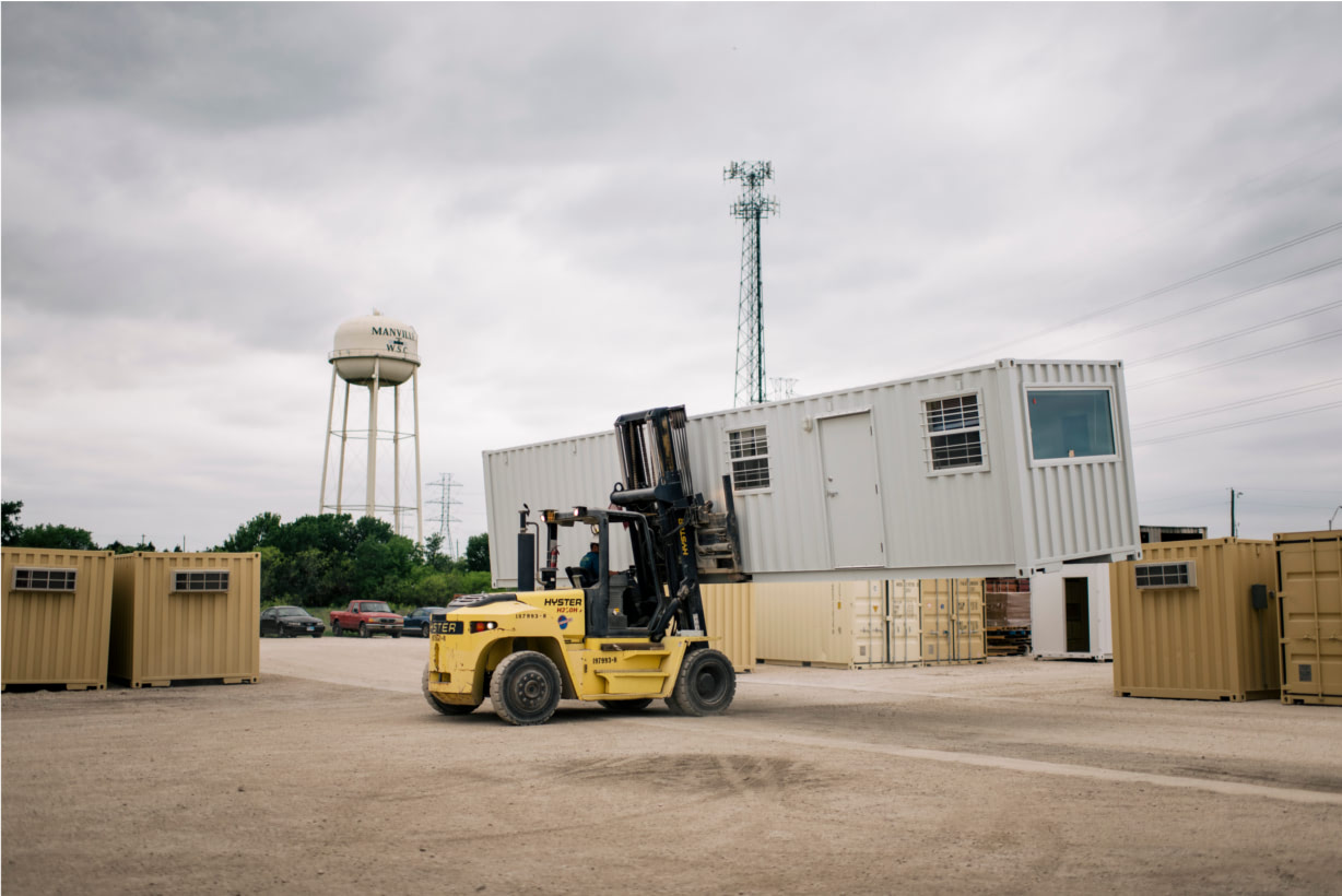 Forklift relocates container office for reuse