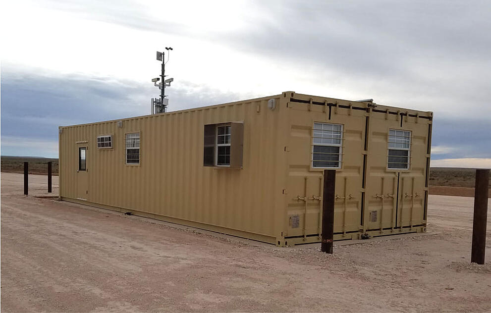Double-wide, 16-foot shipping container office at Air Force base