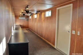 Interior of shipping container modified into an office.